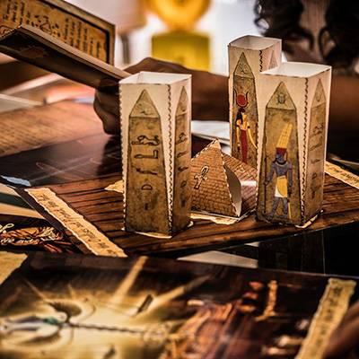 lost-mummy-players-solving-obelisk-2-400x400